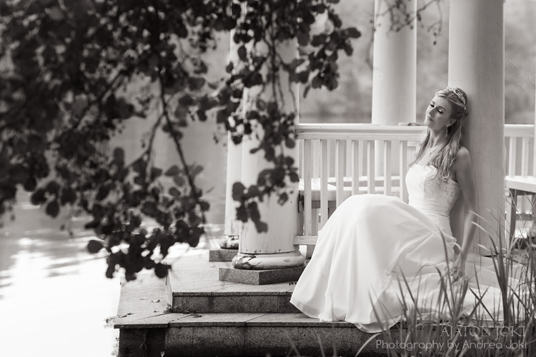 Finnish bride dreamily sitting at a gazebo