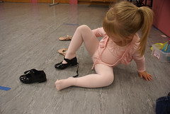 Putting her tap shoes on