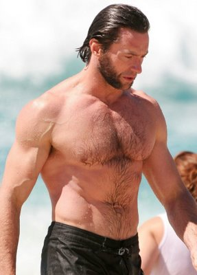 Hugh Jackman and his naked hairy chest walking out of the sea.