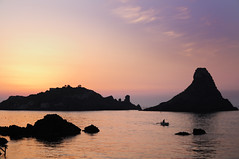 """Islands of the Cyclops at Dawn Sicily Italy - Creative Commons by gnuckx (gnuckx) Tags: pictures travel sunset sea summer vacation sky italy sun beach public rock skyline port landscape island dawn islands bay harbor town nikon rocks flickr italia fishermen pyramid photos creative free commons images cyclops ufo stack cc porto rights wikipedia sicily gps geotag sicilia domain aci trezza wiki basalt cyclop publicdomain isola acitrezza faraglioni ulisse ulises geotaged panoramio ciclopi """"no d5000 reserved"""" cc0 gnuckx kekur"""