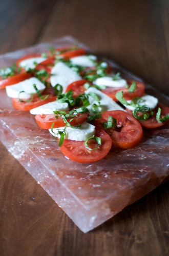 caprese salad on salt block