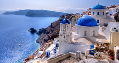 Dreamy Santorini (Surrealize) Tags: ocean travel sea panorama cliff white mountain church water wall architecture island greek volcano town ancient nikon europe mediterranean village aegean atlantis santorini greece international crater caldera venetian hdr oia cyclades bluedome thera d300 14mm geologic surrealize