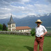 Francis Roucher gazing out on the Alps from his front lawn.