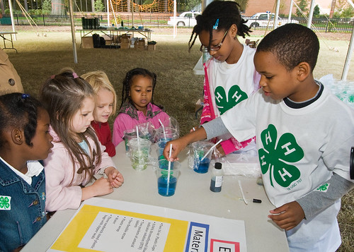 Charles Johnson and Alyssa Campbell fifth grade students demonstrate the effects of carbon dioxide on the atmosphere and what we can do to replace our carbon footprint at Hearst Elementary School in Washington, DC. The experiment was part of the 4-H National Youth Science Day, National Science Experiment, 4-H2O, Tuesday, October 6, 2010.