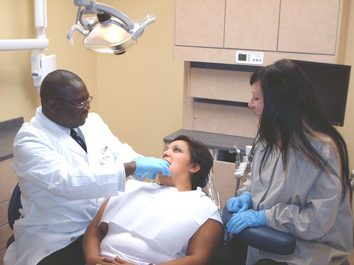 Dr. Theodore Terry and dental assistant Jessica Behnken examine dental patient Lisa Parker. Parker is one of the more than 40,000 patients Health Partners Dental Clinic has provided service to since its inception in 2005.