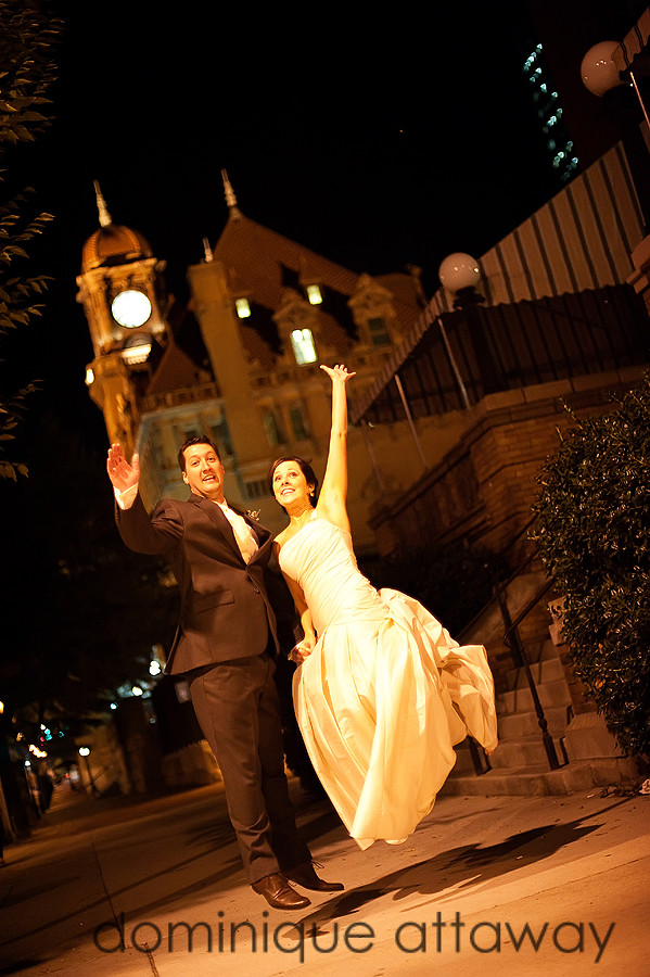 newlyweds jumping in front of Main Street Station in Richmond