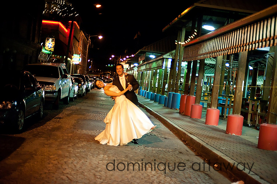 newlyweds in middle of the street at night