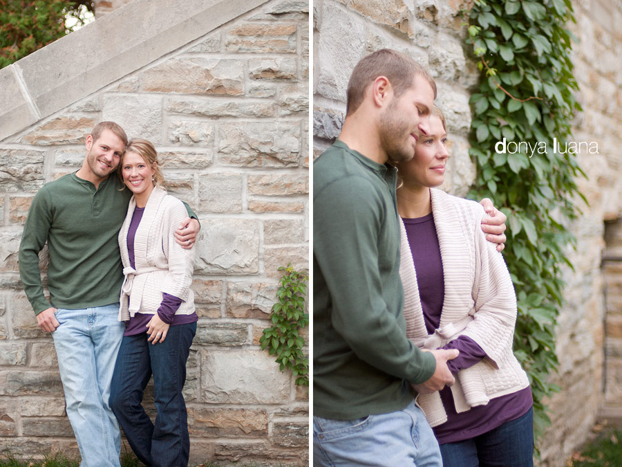 Young, married couple hold hands on St. Olaf College campus for portraits