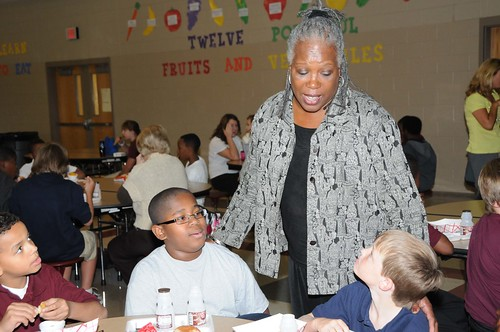 FNS Deputy Administrator for Special Nutrition Programs Audrey Rowe talks with Byram Middle School students during their lunch period following a ceremony in which their school received a HealthierUS School Challenge Gold Award on Oct 14.