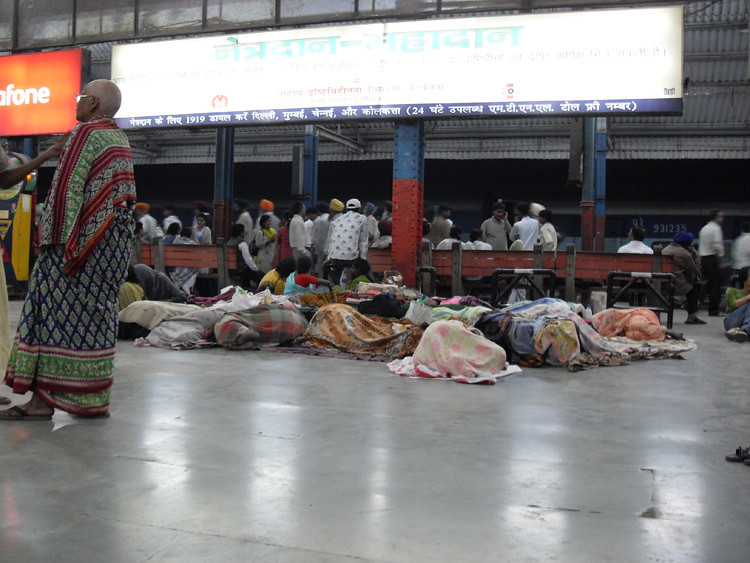 Sleeping women Old Dehli Railway Station