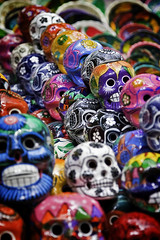 Mexican Ceramic Skulls (jedIII) Tags: pink blue red stilllife orange white black color green yellow canon ceramic skulls mexico skull photo google eyes ruins colorful shot head sale painted teeth picture photographic creepy spooky chichenitza mexican photograph heads cancun vendor hollow myan