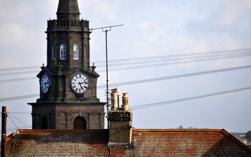 Clock Tower Behind The Rooftop