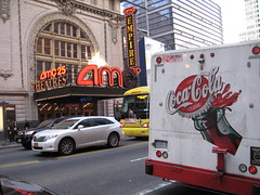 Coke Ad Across from AMC Empire Movie Theater 7171 (Brechtbug) Tags: from street new york city nyc signs classic up architecture truck movie square lite weird theater neon with near manhattan ad coke led advertisement lobby 25 empire times cocacola splash amc across 7th 8th between 42nd avenues 11032010