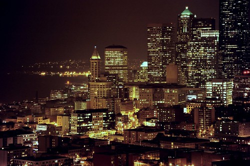 Smith Tower and a hill of skyscrapers, rainy night city: Seattle, from high above on beacon hill, 12th and 13th floors PAC-MED building, amazon.com, Washington state, USA