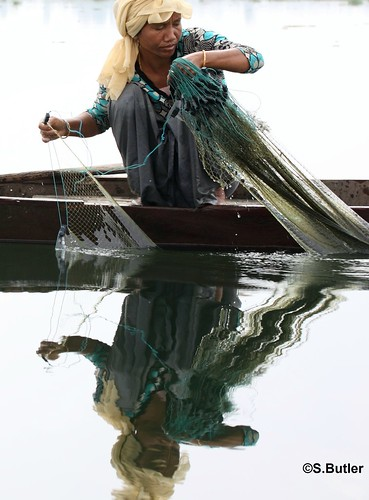 fisherwoman reflections Loktak lake Manipur