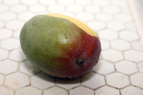 mango, one peel missing