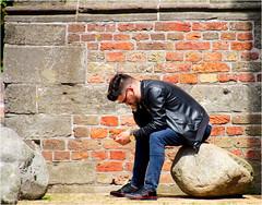 In Thoughts (Hindrik S) Tags: smartphone snoadfoan mobieletelefoon handy mobieltje cellphone boy man mann mensch people minske mens candid strjitte straat street strasse strjitfotografy streetphotography straatfotografie strasenfotografie sonyphotographing sony sonyalpha tamron tamronaf16300mmf3563dillvcpzdmacrob016 16300 2017 paintshoppro aftershot2 jack leather leer elar lear jaske streetphoto