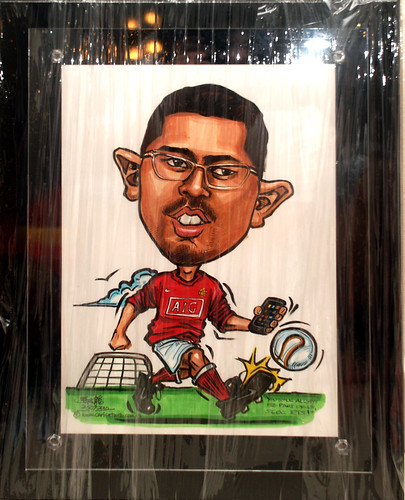 Manchester United soccer caricature with iPhone for People's Association - black acryl;ic frame backing