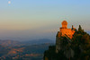 L'ultimo sole e la prima luna / The last sun and the first moon (AndreaPucci) Tags: sun moon castle day hill luna clear sole castello collina repubblicadisanmarino canoneos400 canonefs1855mm3556 andreapucci
