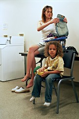 Elana and Son Folding Clothes 1 (neohypofilms) Tags: boy woman color slr film girl socks hair children shoes child legs candid 28mm clothes jeans negative laundry barefoot clogs denim series casual tall concept seated mules washers washing folding dryers drying nylons pentex
