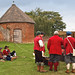 Members of The Sealed Knot talk to a blacksmith in the 16th Century walled garden of Basing House, the site of a siege in the English Civil War