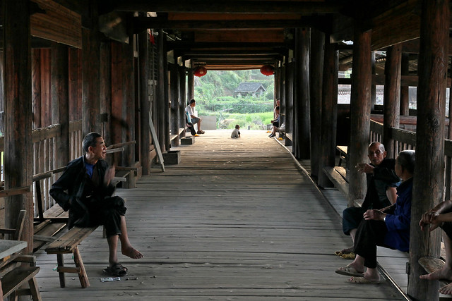 "People in the ""Wind and Rain"" covered bridge, Chengyang, Guangxi, China"