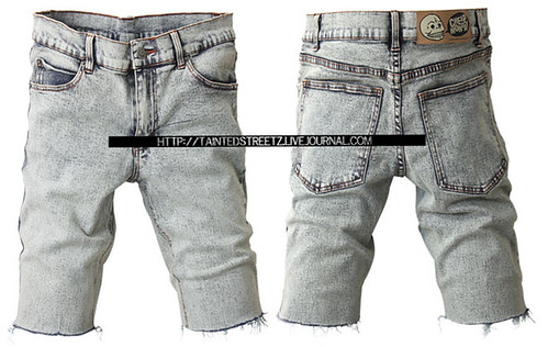 Stone wash ripped knee length shorts