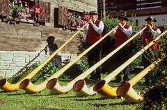 alpenhorns (Ron Layters) Tags: leica mountain switzerland slide velvia transparency zermatt horn tradition musicalinstrument fujichrome nationalcostume wallis traditionaldress valais alpenhorn swissflag r6 swissnationalday mattertal leicar6 ronlayters slidefilmthenscanned 6horns