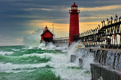 """September Gale""  Grand Haven Breakwater Lighthouse is located in the harbor of Grand Haven, Michigan (Michigan Nut) Tags: light sunset coastguard usa lighthouse storm color green art beach nature water clouds photography evening harbor photo dangerous sand day waves cloudy surfer lakemichigan explore surfboard nautical splash frontpage beacon recent channel grandhaven splashing michiganlighthouses grandhavenmichigan galeforcewinds grandhavenlighthouse explorefrontpage nikon70300mm d700 michigancoastline michigannut"