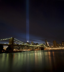 9/11 Tribute Lights. (Vitaliy P.) Tags: new york city bridge light sunset panorama orange building green yellow brooklyn reflections river lights nikon long exposure downtown angle dusk manhattan under 911 wide dumbo overpass down september east explore gothamist tribute 11th verizon explored d80 18135mm vertorama vitaliyp gettylicensed