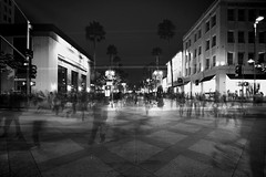 the world is moving really fast (Eric 5D Mark III) Tags: street city longexposure light shadow people blackandwhite bw building tree monochrome night contrast vintage dark vanishingpoint cross santamonica ghost perspective pedestrian wideangle lighttrails 3rdstreet ef1635mmf28liiusm