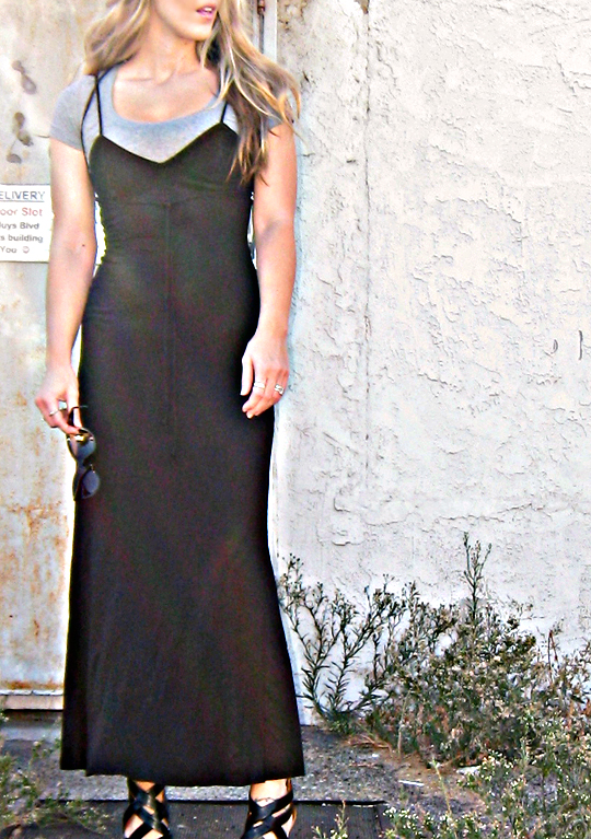 long black 90s dress worn over a t-shirt with strappy wedges+sharp