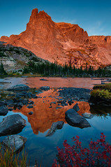 Notchtop Sunrise (Mike Berenson - Colorado Captures) Tags: park morning sky reflection nature water sunrise photography nationalpark nikon colorado allrightsreserved rockymountainnationalpark alpenglow d300 notchtopmountain lakehelene exposurefusion coloradocaptures copyright2010mikeberenson
