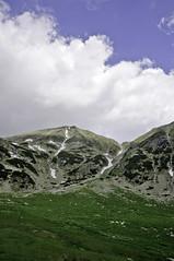 Green valley below Papusa Peak (Horia Varlan) Tags: blue sky white snow green grass clouds rocky valley romania peaks steep retezatmountains papusapeak