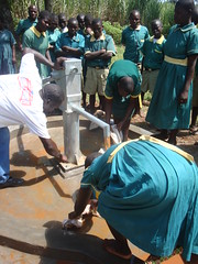 Ebumamu Primary School rehabilitated well-dirty water flowing out after pump installation.