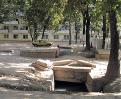 In the streets of Dushanbe, smelling open sewerage system. (Harry -[ The Travel ]- Marmot) Tags: life city urban streets asia open central system tajikistan dushanbe flickrmeet cultural centraal azi smelling sewerage tadzikistan westmeetswestintheeast