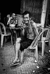 Cigarette and a Table (WPalank) Tags: street bw cambodia southeastasia phnompenh summiluxasph cs5 nikcolorefexpro leicam9 niksilverefexpro nikviveza2