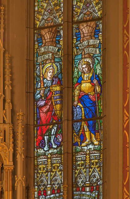 Saint Francis de Sales Oratory, in Saint Louis, Missouri, USA - detail of stained glass windows of Saints Michael and Raphael, Archangels