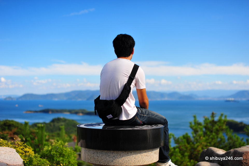The view was magnificent from the top of Washuzan looking out over the Seto Ohashi Bridges. This guy had the best spot perched on the very top. Seems like he was contemplating something as he looked out.