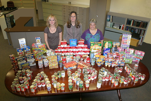 Feds Feed Families:  (left to right), Traci Ross, Farm Service Agency Coordinator; Tammi Schone, Rural Development Coordinator; and Linda Weinzetl, Natural Resources Conservation Service Coordinator with some of the food collected for the backpack program.