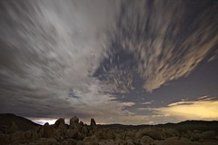 desert storm (Eric 5D Mark III) Tags: california longexposure sky cloud rock stone night landscape star moving nationalpark desert joshuatree wideangle midnight campground whitetank motino ef14mmf28liiusm