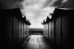 /\/\/\/\ __ /\/\/\/\ (Effe.Effe) Tags: longexposure bw beach monochrome bn huts capanni weldingglassasndfilter