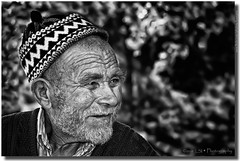 Spirit Of Knowledge (Kuzeytac) Tags: old portrait bw white man black male adam green senior smile face look hat shirt forest turkey hair beard happy person one sweater eyes day alone looking adult side trkiye turkiye gray grandfather calm human elderly age ear knowledge wisdom mustache cheerful ethnic aging beyaz wrinkle eyebrows enjoyment turkish retirement turk leyla aside contemplation hayat trk canakkale caucasian siyah potre supershot ayvacik yal izgiler ifade abigfave canoneos400d ayvack wooven kuzeytac saariysqualitypictures mygearandme mygearandmepremium