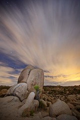 real or surreal? (Eric 5D Mark III) Tags: california longexposure sky cloud motion rock vertical night landscape star moving nationalpark desert joshuatree wideangle midnight campground startrails whitetank ef1635mmf28liiusm