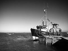 Boat (ant_sk) Tags: sea bw white seascape black water river boat olympus mast tied zuiko e510 1442mm