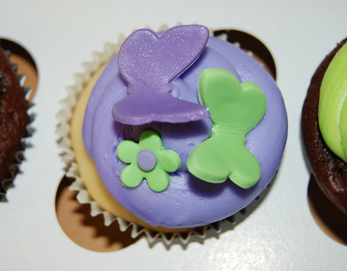 Green and Purple Cupcakes for a Tinkerbell party - topped with butterflies and flowers