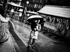 Come rain or come shine (liver1223) Tags: china street 2 people blackandwhite bw photo shot mother taiwan son snap explore taipei greater gr ricoh grd blackwhitephotos grdigital2 mygearandmepremium