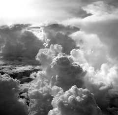 Sky symphony (kevin dooley) Tags: light sky bw cloud white storm black newmexico clouds canon dark square airplane cool nice interesting pretty emotion very good gorgeous superior super monotone front aerial best powershot excellent much emotional symphony billow billowing g7 angrycloud cloudshot emotionalsky skysymphony killercloud abovenewmexico