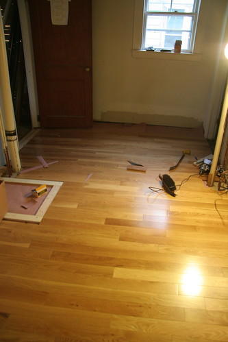 laying hardwood floor in the bathroom