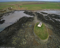 St Cwyfan's Church, near Aberffraw, Anglesey [1] (->>Hamish) Tags: beach church wales island bay aerial kap islet causeway 2011 st llangwyfan aberffraw ancient china sea church photograph kite isle irish porth anglesey cwyfan